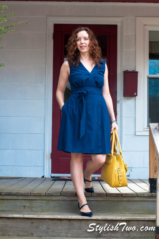 The wrap dress! Go for Navy - Studies have shown it's a power color and customers are more likely to buy what you're selling when you wear blue!