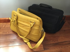 Stylish oversized bag and laptop bag both fit under the seat in front of you or you can put one or both in the overhead bins easily because they are small